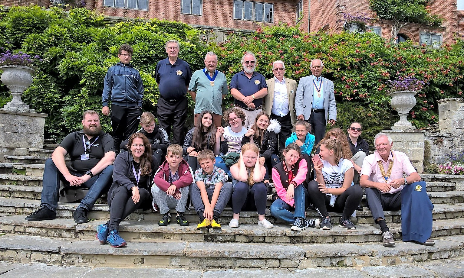 young-carers-on-the-steps-of-port-lympne-house-with-representatives-of-folkestone-channel-hythe-and-romney-marsh-rotary-clubs.jpg